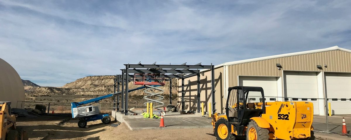 Placing final beam in commercial building project