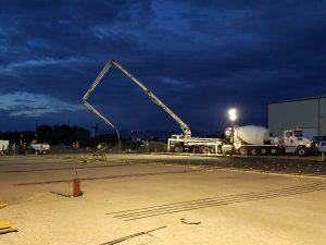 Pouring concrete foundation at business construction site