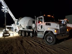 Cement truck at concrete foundation pouring
