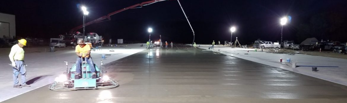Pouring concrete and keeping it wet so it doesn't dry out